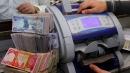 اقتصادي: من الصعب سحب العملة من السوق والعلاق يتحمل مسؤولية الخسائر